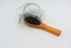 掉头发和头发梳子 库存图片
