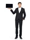 掌上型计算机的生意人暂挂被开张的膝上型计算机 库存图片