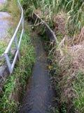 排水设备视图在村庄 免版税库存照片