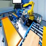 排行机器人的生产 库存图片