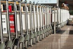 排队的行李台车,北京首都国际机场 图库摄影