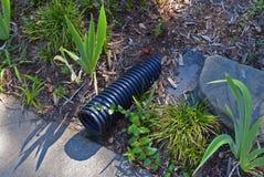 排水设备管子在草坪 免版税库存图片