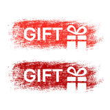 掠过冲程,与圣诞节礼物的白色标志,圣诞节销售的贴纸的标签 红色,深红和蓝色stratched斑点 免版税库存图片