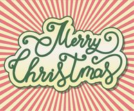 掠过在与镶有钻石的旭日形首饰的作用的背景写的圣诞快乐手书法字法 库存图片