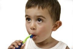 掠过的儿童牙 免版税库存图片