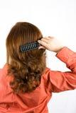 掠过的头发她的妇女 库存照片