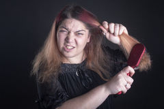 掠过的头发妇女 免版税库存图片