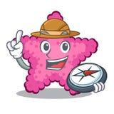 探险家玩具桃红色海星字符桌 皇族释放例证