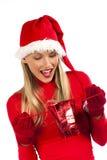 接受圣诞老人的可爱的女孩惊奇 图库摄影