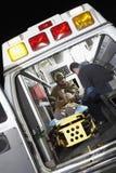 接受在救护车里面的人医疗援助 库存照片