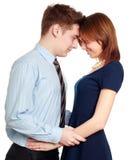 接受在爱的年轻夫妇,愉快微笑,隔绝在白色 库存照片