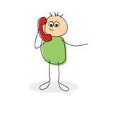 接电话的逗人喜爱的小的动画片棍子形象 库存图片