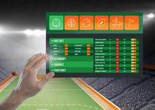 接触一个打赌的App接口体育场的手 库存照片