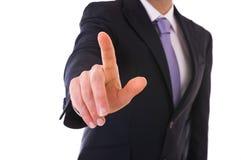 接触一个虚构的屏幕的商人。 免版税库存照片