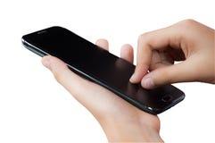 接触智能手机的两个手指 库存照片
