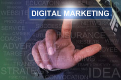 接触DIGITAL在虚屏上的商人营销按钮 库存照片