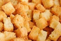 接近的油煎方型小面包片 库存图片