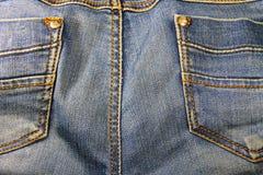接近的牛仔裤射击纹理 一部分的蓝色牛仔裤 库存图片