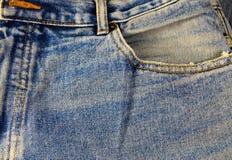 接近的牛仔裤射击纹理 一部分的蓝色牛仔裤 库存照片