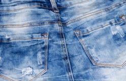 接近的牛仔裤射击纹理 一部分的蓝色牛仔裤 免版税库存图片