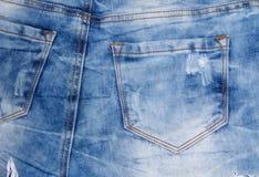 接近的牛仔裤射击纹理 一部分的蓝色牛仔裤 免版税图库摄影