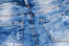 接近的牛仔裤射击纹理 一部分的蓝色牛仔裤 图库摄影