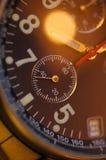 接近的面朝上的手表 图库摄影