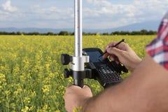 控制器测量学调查油菜籽 免版税库存照片