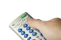 控制拿着远程电视的现有量 免版税库存照片