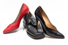 控制权穿上鞋子妇女 库存照片