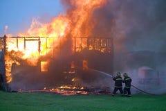 控制消防队员采取 免版税库存照片