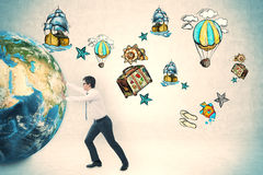 推挤地球近的旅行剪影的商人 库存图片