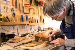 掩没有磁带的仪器制造商一把吉他 免版税库存照片