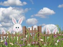 掩藏在草的复活节兔子 免版税图库摄影