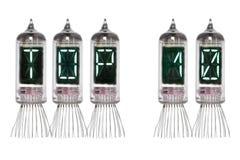 措辞名列前茅10由真正的Nixie真空管显示做了在白色背景 查出 灯显示有绿色背后照明的 图库摄影