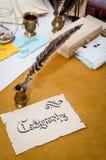 措辞在与书法工具的老纸写的书法 免版税库存照片