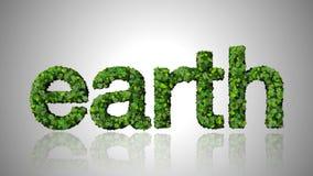 措辞由绿色叶子做的地球在白色背景 库存图片