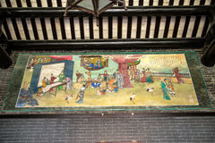描述古老生活的场面在陈家祠的一张五颜六色的绘画 免版税库存照片