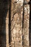 描述妇女的浅浮雕。吴哥窟 免版税库存照片