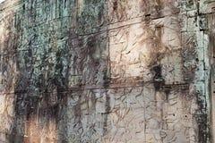 描述战斗场面的浅浮雕。吴哥窟 免版税图库摄影