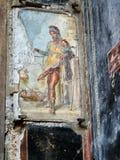 描述神Priapus的古色古香的壁画在庞贝城,意大利 库存图片