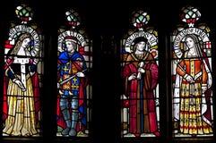 描述约克的亨利七世、伊丽莎白,凯瑟琳Woodville和碧玉托特的污迹玻璃窗 免版税库存图片