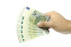 提供五张欧洲钞票的手 免版税库存照片