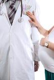 提供白色外套的医生金钱 库存照片