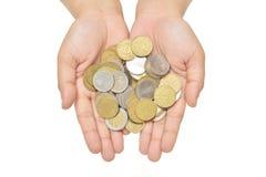 提供许多硬币 免版税库存照片