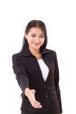 提供震动手势的友好的女商人 免版税库存照片