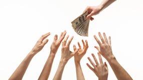 提供援助为金钱的许多手 图库摄影