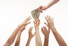 提供援助为金钱的许多手 库存照片