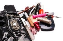 提包和化妆用品 免版税图库摄影