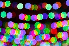 提取与回合行,光芒四射的多彩多姿的光的被弄脏的背景 免版税库存图片